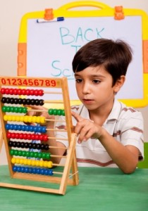 boy using abacus for math