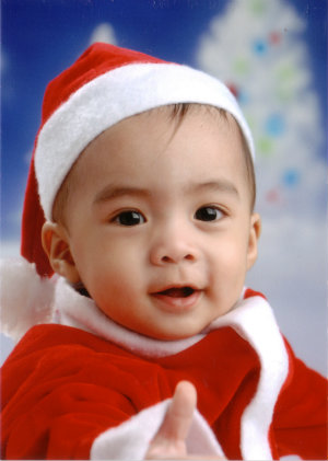 Cute Kid in Santa Clause suit